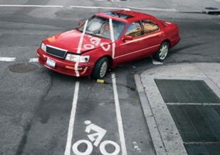 Bike lane painted on top of parked car
