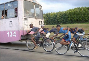 Skitching: bicyclists holding on to a moving bus